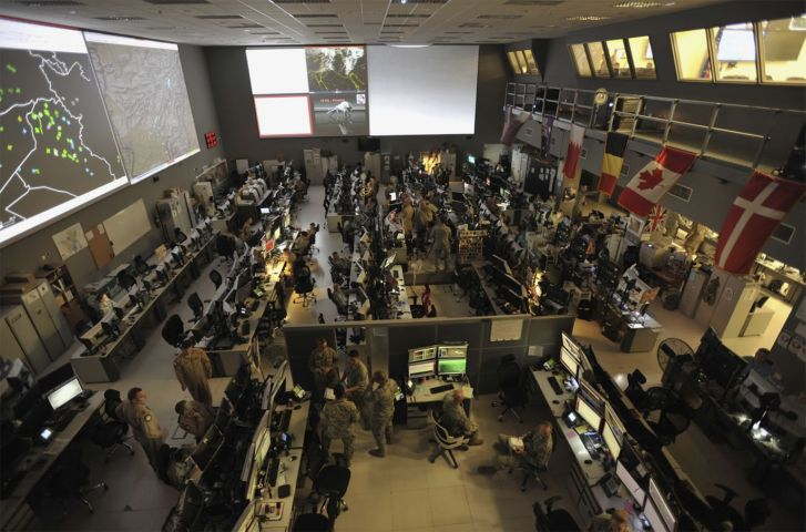US and coalition forces at the Combined Air Operations Center (CAOC), Al Udeid Air Base, Qatar. (US Department of Defense)